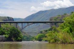 Concrete arch bridge. Modern concrete arch bridge against  background mountains. Mexico Stock Image