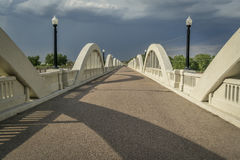 Concrete arch bridge over South Platte River. Rainbow arch bridge over South Platte River in Fort Morgan, Colorado Stock Photo