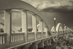 Concrete arch bridge over South Platte River. Rainbow arch bridge over South Platte River in Fort Morgan, Colorado, retro sepia toning Stock Photos