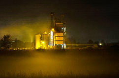 Concrete factory at work. Mix plant for concrete and asphalt by night with fog in front of it stock images