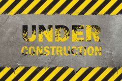 Concrete background with grunge hazard sign stock photography