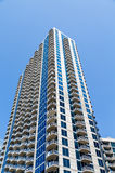 Concrete Balconies Up Blue and White Condo tower Royalty Free Stock Image