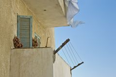 Concrete balcony with turquoise shutters. Royalty Free Stock Images