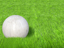 Concrete ball. Sculpture with grass Royalty Free Stock Photos