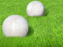 Concrete ball. Sculpture with grass Royalty Free Stock Images