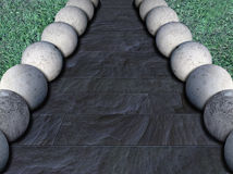 Concrete balls 4. Row sof concrete balls on slate tiles Royalty Free Stock Image