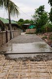 Concrete and bamboo. Making concrete roads in Thailand Stock Image