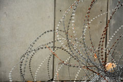 Concrete barrier and barbed wire protection Royalty Free Stock Photos