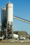 Concrete Batching. A photo of a concrete truck at a concrete batch plant stock photography