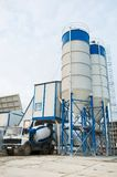 Concrete batching plant. Stationary Concrete Batching Plant unloading cement into mixer truck royalty free stock photography