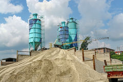 Concrete batching plant. With three silos, heap of sand and gravel royalty free stock images