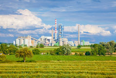 Concrete batching plant,blue sky. Green field stock photo