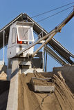 Concrete batching plant. Close up of cabin and bucket with sand at concrete batching plant royalty free stock image