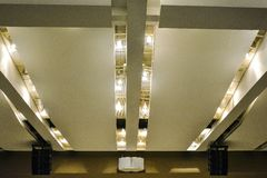 Concrete beams and ceiling with lamps and speakers. Architecture and equipment of large rooms royalty free stock photo
