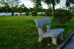 Concrete bench in the park stock images