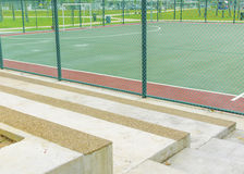 Concrete bench for spectators at futsal court. Stock Images