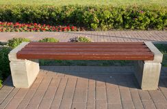 A concrete bench stands in the park stock photography