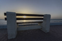 Concrete bench at sunrise Stock Images