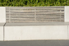Concrete bench with wooden backrest Royalty Free Stock Images