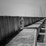 Concrete benches. Black and white of a row of concrete benches royalty free stock images
