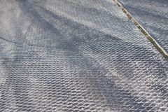 Concrete beton plate covers at airfield with rubber traces left by sport cars tires during drifting competitions. Background pattern photo Royalty Free Stock Photos