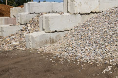 Concrete bins holding rocks and construction material Stock Images