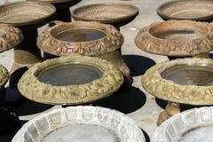 Concrete bird baths holding rain water Royalty Free Stock Image