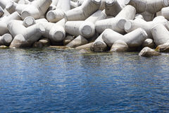 Concrete block breakwater hit by the atlantic waves Royalty Free Stock Images
