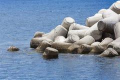 Concrete block breakwater hit by the atlantic waves Stock Photos