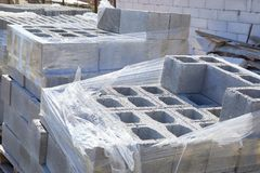 Concrete block bricks in stack for wall construction. stock photos