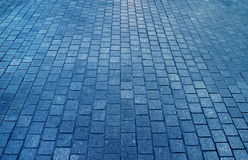 Concrete block paved walkway in blue color, for background Royalty Free Stock Photos