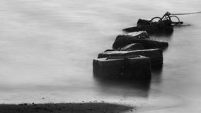 Concrete block in sea with long exposure Royalty Free Stock Images