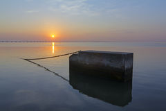 Concrete block in tagus river at sunrise Royalty Free Stock Photo