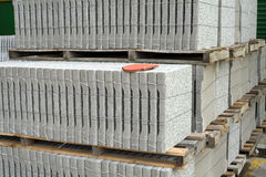 Concrete blocks. Pre-formed blocks of concrete at a Roofing specialist's yard Royalty Free Stock Photography