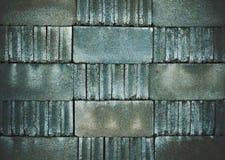 Concrete blocks arranged alternately on the background. royalty free stock photography