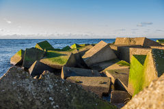 Concrete blocks on beach Royalty Free Stock Photos