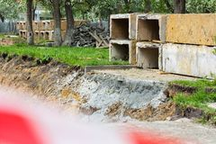 Concrete blocks at a construction site. Street repair. royalty free stock image
