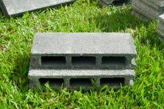 Concrete blocks on grass Stock Image