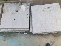 CONCRETE BLOCKS STORED. Several blocks slim form concrete are stored on the floor waiting for their use in the construction of buildings Royalty Free Stock Photo