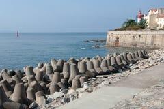 Concrete blocks tetrapod breakwater protect Ajaccio harbor. French island of Corsica stock photography