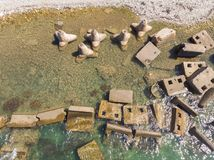 Concrete blocks and tetrapods on the beach. Top aerial view made by drone royalty free stock photos