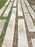 Concrete blokken voor voetpadden met kiezelstenen in hoekje Royalty-vrije Stock Foto
