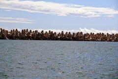 Concrete boundary at the sea Stock Photos