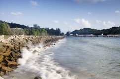 Concrete breakwater along the coastline to protect mainland from heavy waves Royalty Free Stock Photos