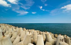 Concrete breakwater by the sea Royalty Free Stock Image