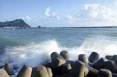 Concrete breakwater to protect coastline Royalty Free Stock Images