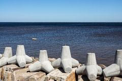 Concrete breakwaters on the bank of sea gulf Stock Photography