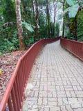 Concrete brick pathway with the metal railing. Stock Photos