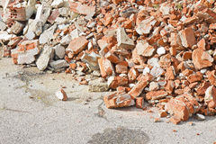 Concrete and brick rubble debris on construction site after a de. Molition of a brick building Stock Photography