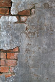 Concrete and brick texture. Cracked concrete revealing a brick layer below Royalty Free Stock Photos